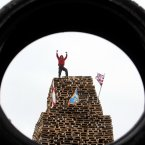 A man stands on top of the New Mossley bonfire (Paul Faith/PA Wire)