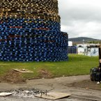 A child plays beside a massive bonfire in the Shankill Estate in West Belfast (AP Photo/Peter Morrison)