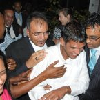 Avinash Treebhoowoon (white shirt) outside the Supreme Court in Port Louis, Mauritius, after he was acquitted of murdering honeymooner Michaela McAreavey.