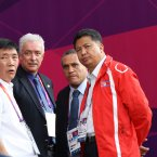 North Korean official Son Kwang Ho (second right) talks to other officials as the Colombia v North Korea Women's Football, First Round, Group G match was delayed due to the flag mix-up. (EMPICS Sport/EMPICS Sport)