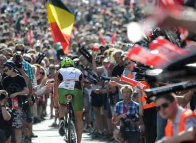 Competitors battle through the crowds during the 180km bike leg in Roth. 