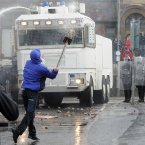 Police deploy the water canon to disperse protesters (Photo: Laura Hutton/Photocall Ireland)
