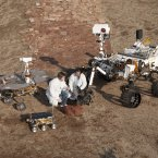 Two spacecraft engineers sit among three generations of Mars rovers at NASA's Jet Propulsion Lab in California, January 2012. (Image: NASA/JPL-Caltech)