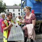 Local resident Rosemary McGinn collects water from a city council tanker. (Photo: Sasko Lazarov/Photocall Ireland)