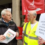 Socialist Party TD Joe Higgins speaks to Greencore worker David Sensiea from Hull during today's demonstration. (Photo: Sam Boal/Photocall Ireland)