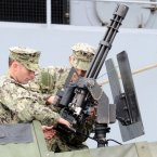 S Marines pictured setting up a mini-gun on board a gun boat outside the USS Fort McHenry. (Photo: Laura Hutton/Photocall Ireland)