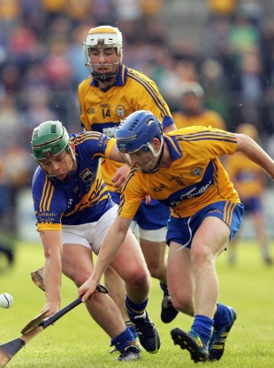 Tipperary's Andrew Ryan under pressure from Conor McGrath and Padraic Collins of Clare