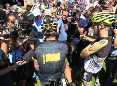 Lance Armstrong, center, talks to reporters after his second-place finish in the Power of Four race in Aspen, Colorado on Saturday.