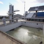 The diving well at the Aquatics Center, drained of water.