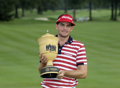 Keegan Bradley holds up the trophy after winning the Bridgestone Invitational.