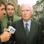 Questioning the former Chairman of Allied Irish Bank, Jim Culliton (c), as he leaves the Public Accounts Committee hearings in Kildare House in Dublin in 1998.