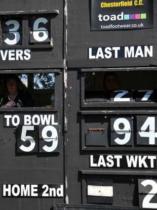 An old fashioned cricket scoreboard in operation at Queens Park, Chesterfield, England.