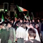 Republicans celebrate the beginning of the IRA ceasefire in West Belfast. Image: McCullou/PA Archive