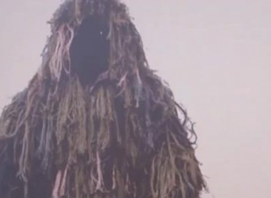 An example of the 'ghillie' suit clothing worn by the man.