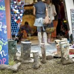 Wellies are left outside a craft shop in the green fields area of Glastonbury festival at Worthy Farm, Pilton. Pic: Ben Birchall/PA Wire