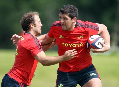 James Downey, in his second coming at Munster, is tackled by Duncan Williams.