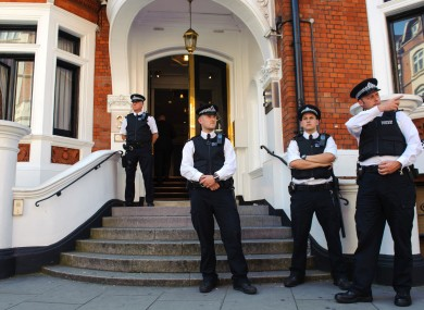 Police officers outside the Ecuadorian Embassy in Knightsbridge, London, where Wikileaks founder Julian Assange is claiming asylum in an effort to avoid extradition to Sweden.