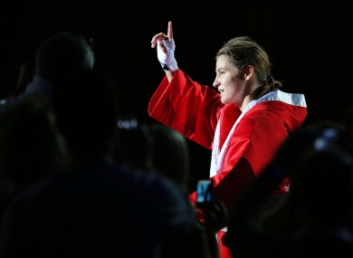 Katie Taylor takes the ExCel Arena crowd's applause. 