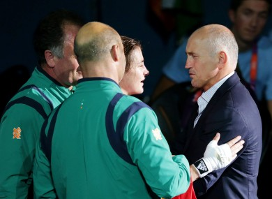 Ireland's Katie Taylor is congratulated by Barry McGuigan.