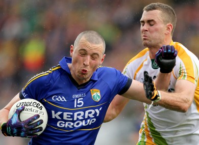 Eamonn McGee of Donegal faces up to Kerry's Kieran Donaghy. 