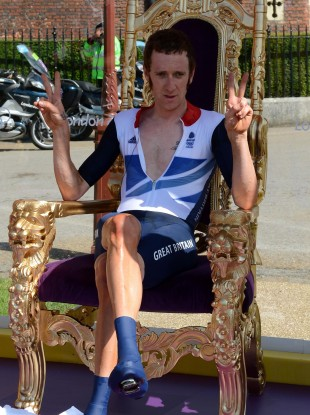 Great Britain's Bradley Wiggins sits on the throne as he celebrates winning the Men's Individual Time Trial today. It's a good look.
