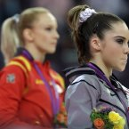U.S. gymnast McKayla Maroney, right, stand along with Romania's gymnast Sandra Raluca Izbasa during the podium ceremony for the artistic gymnastics women's vault finals at the 2012 Summer Olympics
