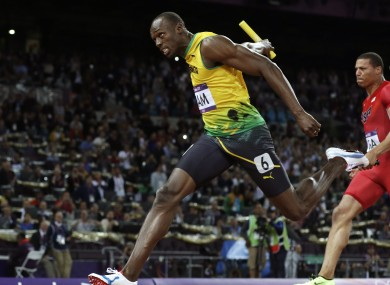 Jamaica's Usain Bolt, left, crosses the finish line ahead of Ryan Bailey of the United States in the men's 4x100-meter relay final.