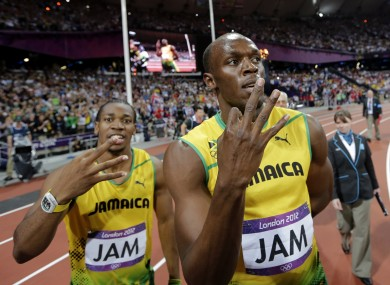 Blake and Bolt celebrate after setting a relay world record.