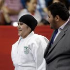 Saudi Arabia's Wojdan Shaherkani reacts after the women's 78-kg judo competition against Puerto Rico's Melissa Mojica at the 2012 Summer Olympics, Friday, Aug. 3, 2012, in London. (AP Photo/Paul Sancya)
