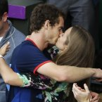 Andy Murray of Great Britain kisses his girlfriend, Kim Sears, after Murray defeated Roger Federer of Switzerland in the men's singles gold medal match at the All England Lawn Tennis Club at Wimbledon, in London, at the 2012 Summer Olympics, Sunday, Aug. 5, 2012. (AP Photo/Mark Humphrey)