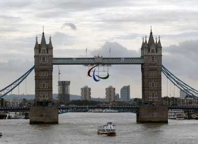 The Paralympics logo hangs over Tower Bridge in London just the Olympic rings did recently.