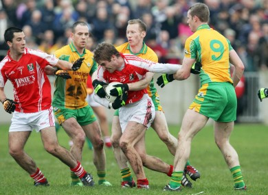 Corofin's Michael Comer tackles Tuam Stars Gary O'Donnell in last year's Galway senior football final.