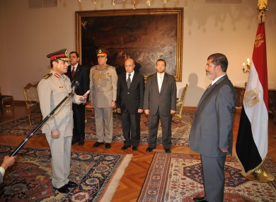 gyptian President Mohammed Morsi, left, swears in newly-appointed Minister of Defense, Lt. Gen. Abdel-Fattah el-Sissi, in Cairo, Egypt, Sunday, Aug. 12, 2012