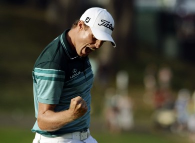 In contention: Nick Watney celebrates after sinking a birdie putt at the Barclays.