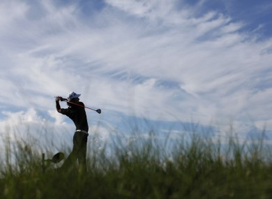 Ryo Ishikawa of Japan watches his tee shot on the 11th hole during the first round.