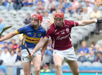Ronan Maher of Tipperary with Michael Mullins of Galway.