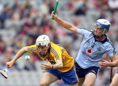 Clare's Shane O'Donnell is challenged by Eric Lowndes of Dublin during today's game.