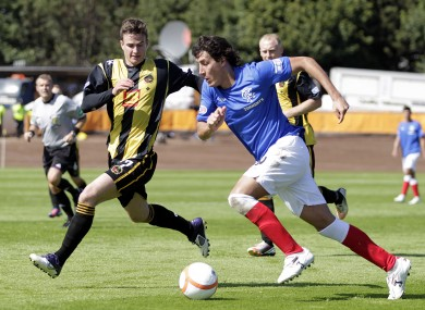 Berwick Rangers' Steven Notman (left) battles with Rangers' Francisco Sandaza during the Scottish Division 3 match.