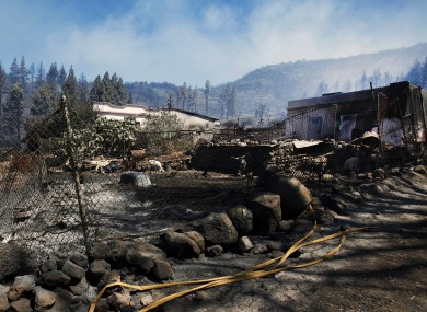 A scorched and burnt farm appears after the ravages of a wildfire which swept through parts of La Gomera, the Canary Islands