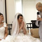 Huang Mei-yu, left, and her partner You Ya-ting are greeted by Buddhist nun Shih Chao-hui before they take part in Taiwan's first same-sex Buddhist ceremonial wedding in Taoyuan, Taiwan, Saturday. (AP Photo/Wally Santana)