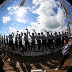 Sailors from the Cuauhtemoc a Mexican Tall Ship wave goodbye as the ship sails out of Dublin Harbour yesterday.