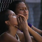 Relatives of a inmate cry while waiting for information outside Yare I prison in San Francisco de Yare, Venezuela. More than 20 people were killed in a prison riot last Sunday as two groups of inmates waged a gun-battle inside the penitentiary, Venezuelan officials said Monday. (AP Photo/Fernando Llano)