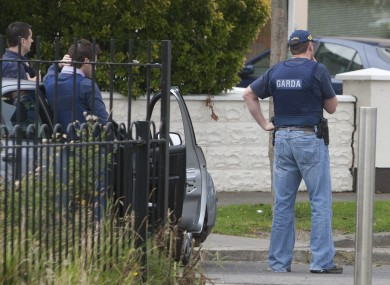 Garda outside the home of Alan Ryan in north Dublin yesterday.