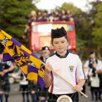 A young Wexford fan leads the open-top bus on its parade.