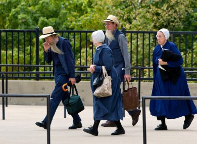 Members of the Amish community entering the courthouse in Cleveland