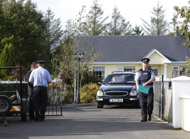 A hearse removes the body of Anthony Ward from his home at Harrison Place, Charleville, Co Cork today.