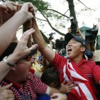 2008: USA's Anthony Kim celebrates with fans after winning the Ryder Cup at Valhalla.