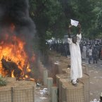 A Sudanese protester stands on a barricade during a demonstration in Khartoum, Sudan, today, as part of widespread anger across the Muslim world about a film ridiculing Islam's Prophet Muhammad. 