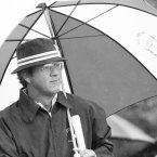 1975: US captain Arnold Palmer stands under an umbrella and watches his team tee off at Laurel Valley Golf Club.