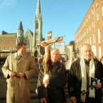 A Catholic priest carries a crucifix at an anti-divorce rally in Dublin in November 1995. Image: Photocall Ireland